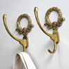 1920s decorative brass wall hooks