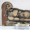 Large wooden cutout of Jesus recumbent