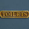 Early-1900s brass pub sign: Toilets
