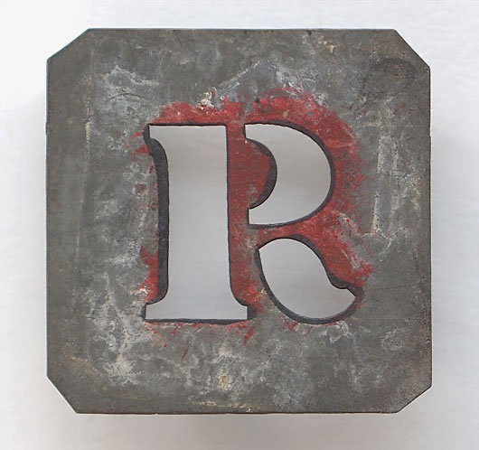 Early-1900s vintage French zinc metal letter stencil: 'R'