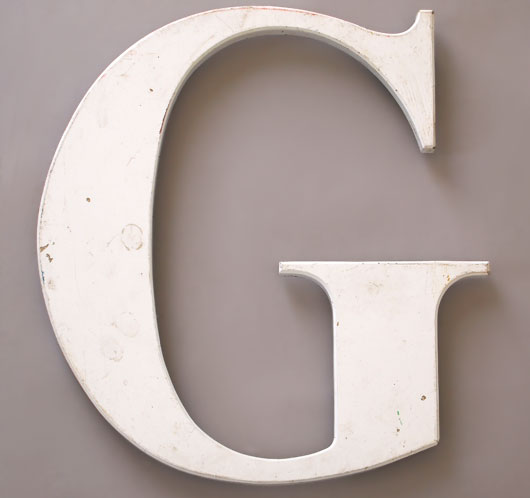 Large white ex-store front vintage serif letter 'G'