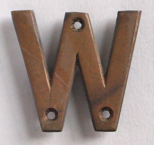 Small early-1900s cast-bronze sign letter 'W'