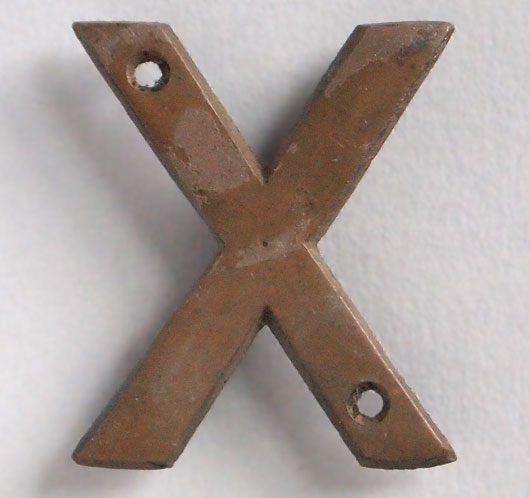Small early-1900s cast-bronze sign letter 'X'