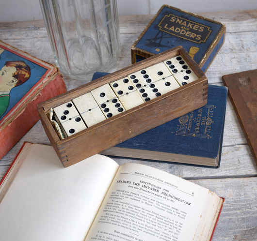 Box of early-1900s antique ivory and wood dominoes